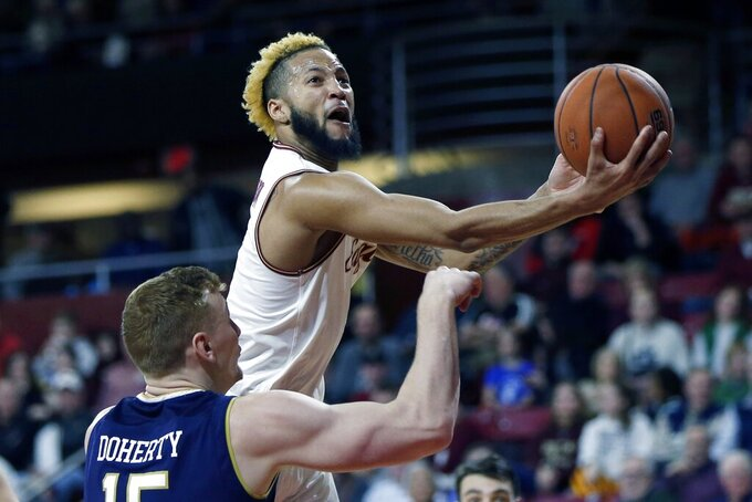 Boston College's Ky Bowman shoots over Notre Dame's Chris Doherty (15) during the first half of an NCAA college basketball game in Boston, Saturday, Feb. 2, 2019. (AP Photo/Michael Dwyer)
