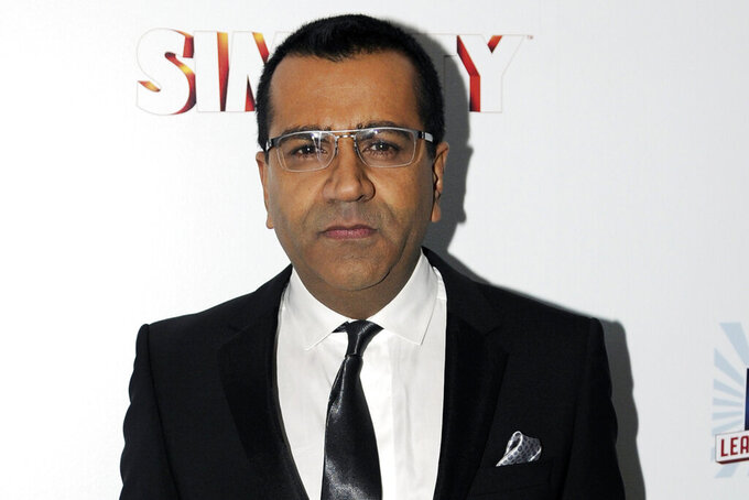 """FILE - This Jan. 22, 2013 file photo shows Martin Bashir at the EA SimCity Learn. Build. Create. Inauguration After-Party, in Washington. An investigation has found that a BBC journalist used """"deceitful behavior"""" to secure an explosive interview with Princess Diana in 1995, in a """"serious breach"""" of the broadcaster's guidelines. The probe came after Diana's brother, Charles Spencer, made renewed complaints that journalist Martin Bashir used false documents and other dishonest tactics to persuade Diana to agree to the interview. (Photo by Nick Wass/Invision/AP, File)"""