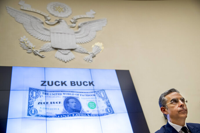 Facebook CEO Mark Zuckerberg's face is visible on a mock