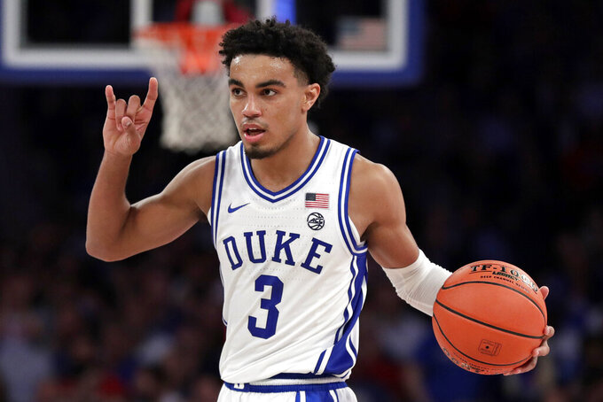 Duke guard Tre Jones signals to teammates during the second half of the team's NCAA college basketball game against Kansas on Tuesday, Nov. 5, 2019, in New York. (AP Photo/Adam Hunger)