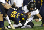 California linebacker Evan Weaver (89) tackles Colorado quarterback Steven Montez (12) during the first half of an NCAA college football game in Berkeley, Calif., Saturday, Nov. 24, 2018. (AP Photo/Jeff Chiu)