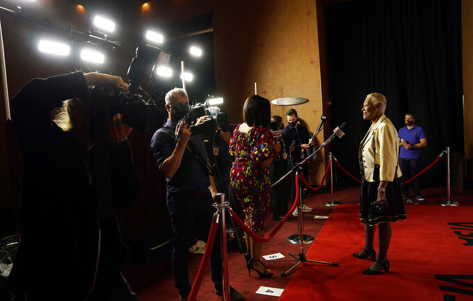 """Singer Dionne Warwick, right, subject of """"Dionne Warwick: Don't Make Me Over,"""" addresses the media at the premiere of the documentary film at the 2021 Toronto International Film Festival, Saturday, Sept. 11, 2021, in Toronto. (AP Photo/Chris Pizzello)"""
