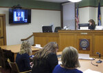 Missoula County Justice Court Judge Marie Andersen reads Francis Crowley, appearing by videoconference, his rights in a court hearing in Missoula, Mont., on Tuesday, July 10, 2018. Crowley is accused of abandoning a 5-month-old boy in the woods of western Montana for more than nine hours. (AP Photo/Matt Volz)