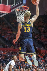 Michigan forward Ignas Brazdeikis (13) goes up with a shot during the second half of the team's NCAA college basketball game against Illinois in Champaign, Ill., Thursday, Jan. 10, 2019. (AP Photo/Rick Danzl.)