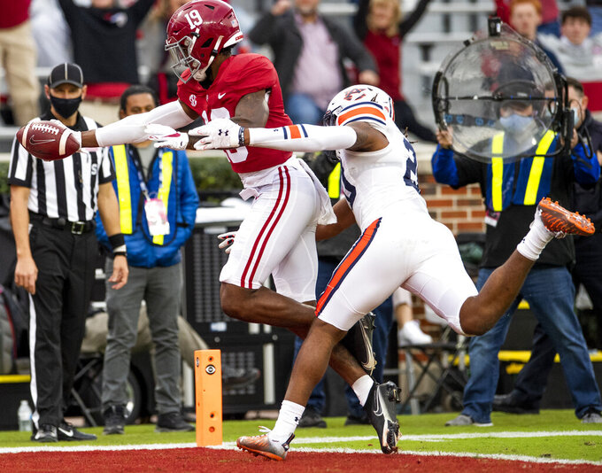 Alabama tight end Jahleel Billingsley (19) scores a touchdown against Auburn defensive back Jamien Sherwood (20) during an NCAA college football game Saturday, Nov. 28, 2020, in Tuscaloosa, Ala. (Mickey Welsh/The Montgomery Advertiser via AP)