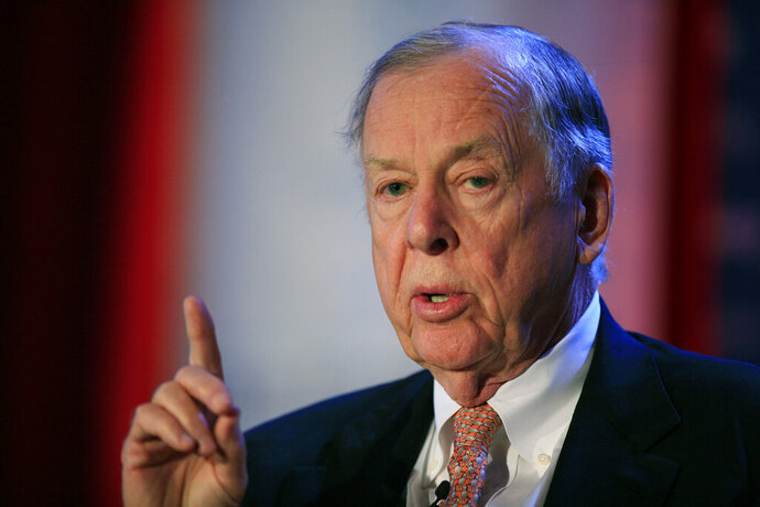 FILE - In this June 15, 2009, file photo, T. Boone Pickens, president of BP Capital Group, speaks at Time Warner's headquarters in New York. Pickens, a brash and quotable oil tycoon who grew even wealthier through corporate takeover attempts, died Wednesday, Sept. 11, 2019. He was 91. (AP Photo/Mark Lennihan, File)