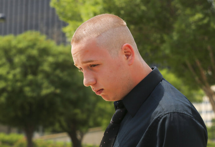 Shane Gaskill, 19, of Wichita, Kan., leaves the federal court in Wichita, Wednesday, June 13, 2018. Gaskill and Casey Viner, 18, of North College Hill, Ohio, online gamers whose alleged dispute over a $1.50 Call of Duty WWII video game bet ultimately led police to fatally shoot a Kansas man, pleaded not guilty Wednesday to charges related to the