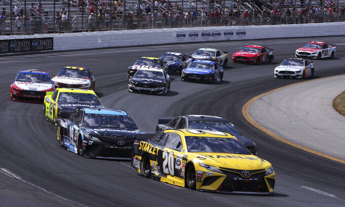 Erik Jones (20) banks into the first turn during a NASCAR Cup Series auto race at New Hampshire Motor Speedway in Loudon, N.H., Sunday, July 21, 2019. (AP Photo/Charles Krupa)