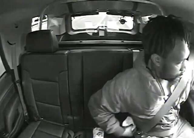 In this image taken from May 23, 2020, video released by the New Jersey Attorney General's Office, Maurice Gordon, of Poughkeepsie, N.Y., he unbuckles his seatbelt before exiting a New Jersey State Trooper's vehicle in Bass River, N.J. Gordon was fatally shot by the state trooper. The Gordon family's attorney and more than 100 groups on Tuesday, Oct. 20, 2020, called on lawmakers to pass police accountability legislation. (New Jersey Attorney General's Office via AP)