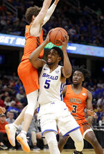 Buffalo's CJ Massinburg, right, drives against Bowling Green's Dylan Frye during the first half of an NCAA college basketball championship game of the Mid-American Conference men's tournament, Saturday, March 16, 2019, in Cleveland. Frye was called for the foul. (AP Photo/Tony Dejak)