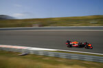 Red Bull driver Max Verstappen of the Netherlands steers his car through one of the banked corners during the first free practice ahead of Sunday's Formula One Dutch Grand Prix at the Zandvoort racetrack, Netherlands, Friday, Sept. 3, 2021. (AP Photo/Francisco Seco)