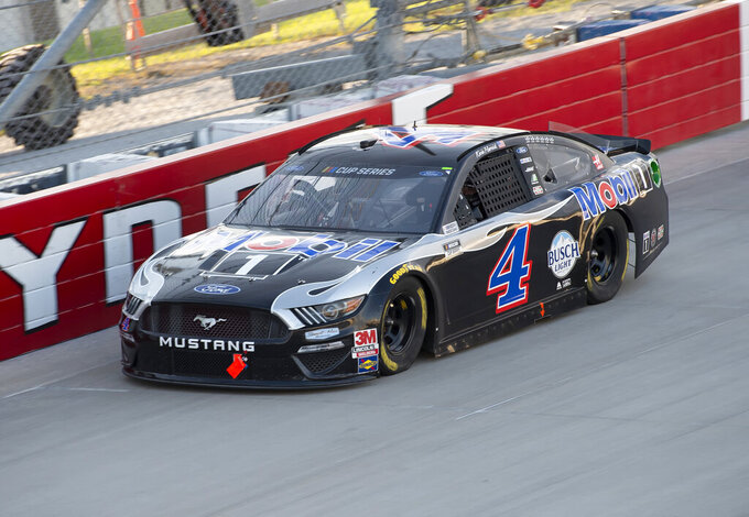 Kevin Harvick (4) competes during a NASCAR Cup Series auto race at Dover International Speedway, Sunday, Aug. 23, 2020, in Dover, Del. (AP Photo/Jason Minto)
