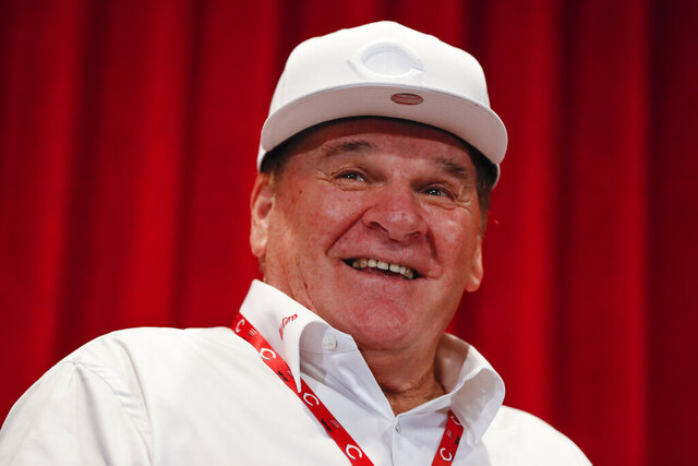 FILE - In this June 17, 2017, file photo, former Cincinnati Reds player Pete Rose attends a news conference during his statue dedication ceremonies before a baseball game between the Reds and the Los Angeles Dodgers in Cincinnati. Rose once again asked Major League Baseball to end his lifetime ban, saying the penalty is unfair compared with discipline for steroids use and electronic sign stealing. Rose's lawyers submitted the application Wednesday, Feb. 5, 2020, to baseball Commissioner Rob Manfred, who in December 2015 denied the previous request by the career hits leader.  (AP Photo/John Minchillo, File)