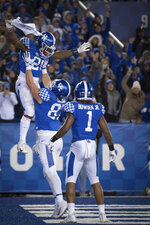 Kentucky running back Benny Snell Jr. (26), tight end C.J. Conrad (87) and wide receiver Lynn Bowden Jr. (1) celebrate Snell's touchdown during the second half of an NCAA college football game against Vanderbilt in Lexington, Ky., Saturday, Oct. 20, 2018. (AP Photo/Bryan Woolston)