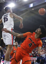 Gonzaga forward Brandon Clarke (15) blocks a shot by Pacific guard Roberto Gallinat (4) during the first half of an NCAA college basketball game in Spokane, Wash., Thursday, Jan. 10, 2019. (AP Photo/Young Kwak)