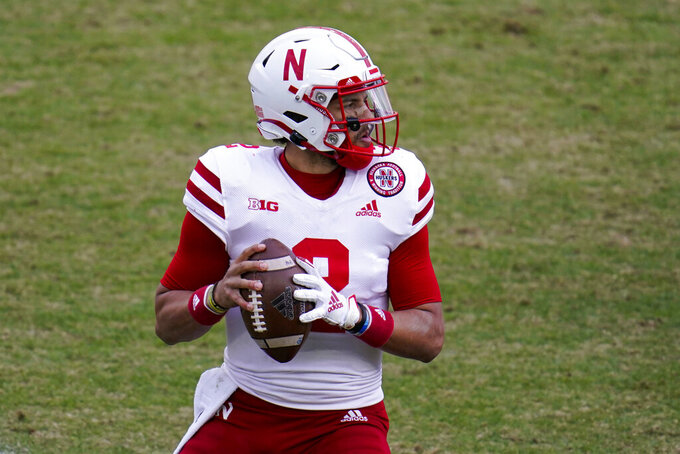 Nebraska quarterback Adrian Martinez (2) throws against Purdue during the fourth quarter of an NCAA college football game in West Lafayette, Ind., Saturday, Dec. 5, 2020. Nebraska defeated Purdue 37-27. (AP Photo/Michael Conroy)