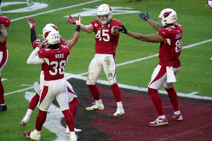 Arizona Cardinals linebacker Dennis Gardeck (45) celebrates his sack of Philadelphia Eagles quarterback Jalen Hurts during the first half of an NFL football game, Sunday, Dec. 20, 2020, in Glendale, Ariz. (AP Photo/Ross D. Franklin)