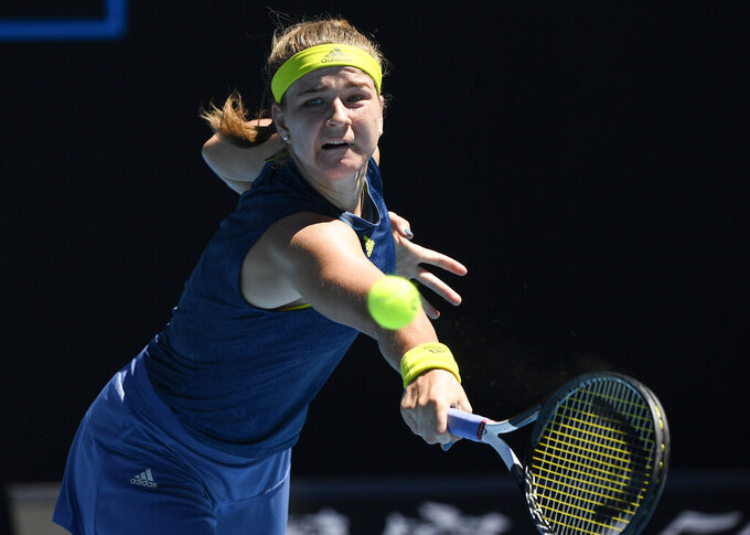 Karolina Muchova of the Czech Republic hits a backhand return to Australia's Ash Barty during their quarterfinal match at the Australian Open tennis championship in Melbourne, Australia, Wednesday, Feb. 17, 2021.(AP Photo/Andy Brownbill)