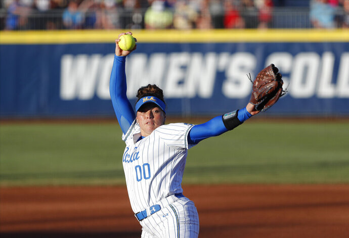 FILE - In this June 4, 2019, file photo, UCLA's Rachel Garcia pitches against Oklahoma during the first inning of Game 2 of the best-of-three championship series in the NCAA softball Women's College World Series in Oklahoma City. UCLA softball player Rachel Garcia has been named Collegiate Woman Athlete of the Year. Garcia was presented with the Honda Cup on Monday night, June 24, 2019, in a ceremony at Galen Center on the USC campus.(AP Photo/Alonzo Adams, File)