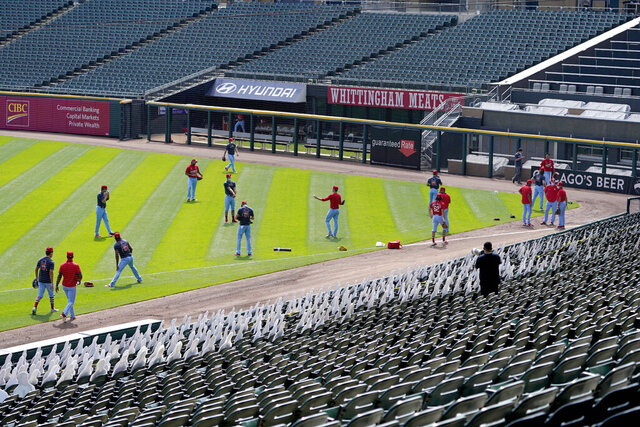 The St. Louis Cardinals workout before a baseball game against the Chicago White Sox Saturday, Aug. 15, 2020, in Chicago. (AP Photo/Charles Rex Arbogast)