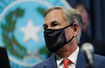 Texas Gov. Greg Abbott wears a face mask as he arrives for a news conference where he provided an update to Texas' response to COVID-19, Thursday, Sept. 17, 2020, in Austin, Texas. (AP Photo/Eric Gay)