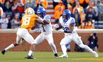 Kentucky running back Benny Snell Jr. (26) runs for yardage as teammate wide receiver Lynn Bowden Jr. (1) blocks Tennessee defensive back Nigel Warrior (18) in the first half of an NCAA college football game Saturday, Nov. 10, 2018, in Knoxville, Tenn. (AP Photo/Wade Payne)