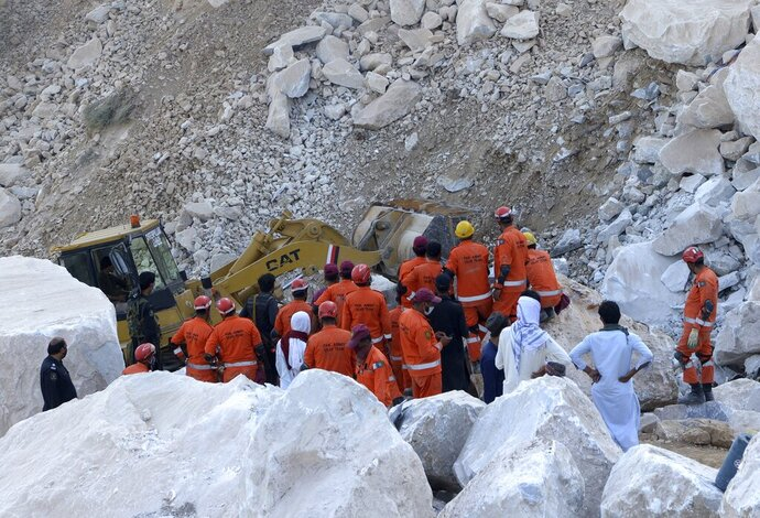 Rescuer workers search for bodies at the site of a marble mine that collapsed in Mohmand, Pakistan, near the Afghan border, Tuesday, Sept. 8, 2020. Pakistani officials said rescue crews using heavy machinery have pulled eight more bodies from the mine in the country's northwest. This raises the death toll from Monday's incident to more than 15. (AP Photo/Zubair Khan)