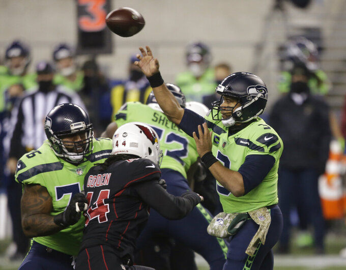 Seattle Seahawks quarterback Russell Wilson passes against the Arizona Cardinals during the first half of an NFL football game, Thursday, Nov. 19, 2020, in Seattle. (AP Photo/Lindsey Wasson)