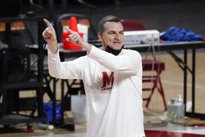 Maryland head coach Mark Turgeon talks to his team during a workout at the team's NCAA college basketball media day, Tuesday, Oct. 12, 2021, in College Park, Md. (AP Photo/Julio Cortez)