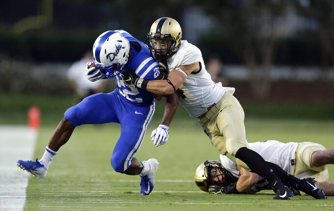 Duke's Brittain Brown (22) is forced out of bounds by Army's Max Regan during the first half of an NCAA college football game in Durham, N.C., Friday, Aug. 31, 2018. (AP Photo/Gerry Broome)