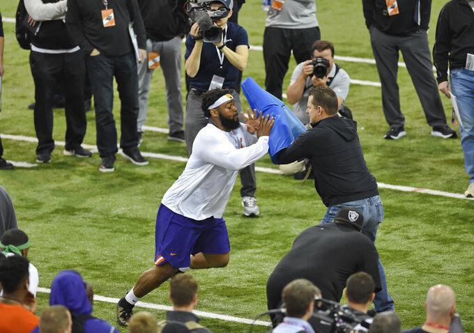 Clemson's Dexter Lawrence,left, runs drills during NFL Pro Day Thursday, March 14, 2019, in Clemson, S.C. (AP Photo/Richard Shiro)