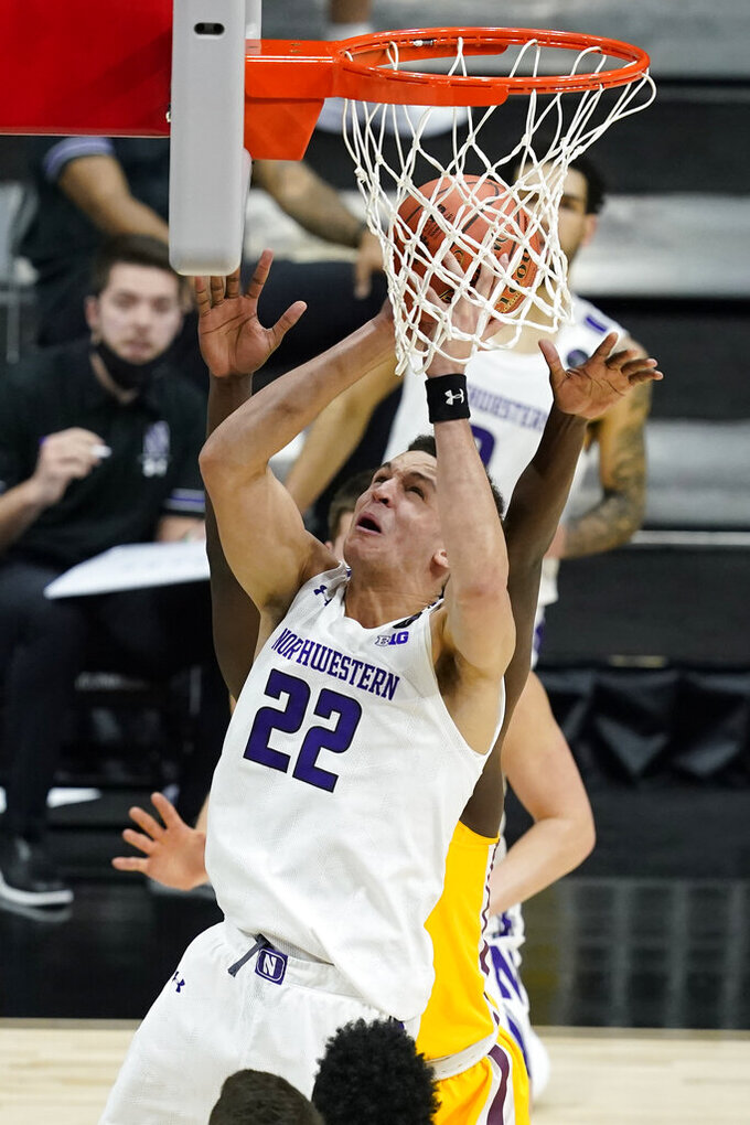 Northwestern's Pete Nance (22) puts up a shot during the second half of an NCAA college basketball game against Minnesota at the Big Ten Conference tournament, Wednesday, March 10, 2021, in Indianapolis. Minnesota won 51-46. (AP Photo/Darron Cummings)