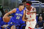 Orlando Magic's Aaron Gordon (00) makes a move to get around Houston Rockets forward Danuel House Jr. (4) during the first half of an NBA basketball game, Friday, Dec. 13, 2019, in Orlando, Fla. (AP Photo/John Raoux)