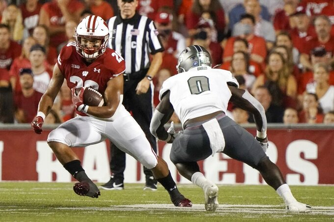 Wisconsin's Isaac Guerendo runs during the first half of an NCAA college football game against Eastern Michigan Saturday, Sept. 11, 2021, in Madison, Wis. (AP Photo/Morry Gash)