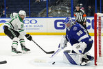 Tampa Bay Lightning goaltender Andrei Vasilevskiy (88) makes a save on a shot by Dallas Stars center Tyler Seguin (91) during the third period of an NHL hockey game Wednesday, May 5, 2021, in Tampa, Fla. (AP Photo/Chris O'Meara)