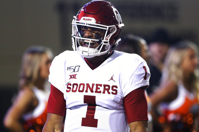 Oklahoma quarterback Jalen Hurts (1) yells in celebration after scoring a touchdown during an NCAA college football game against Oklahoma State, Saturday, Nov. 30, 2019, in Stillwater, Okla. (Ian Maule/Tulsa World via AP)