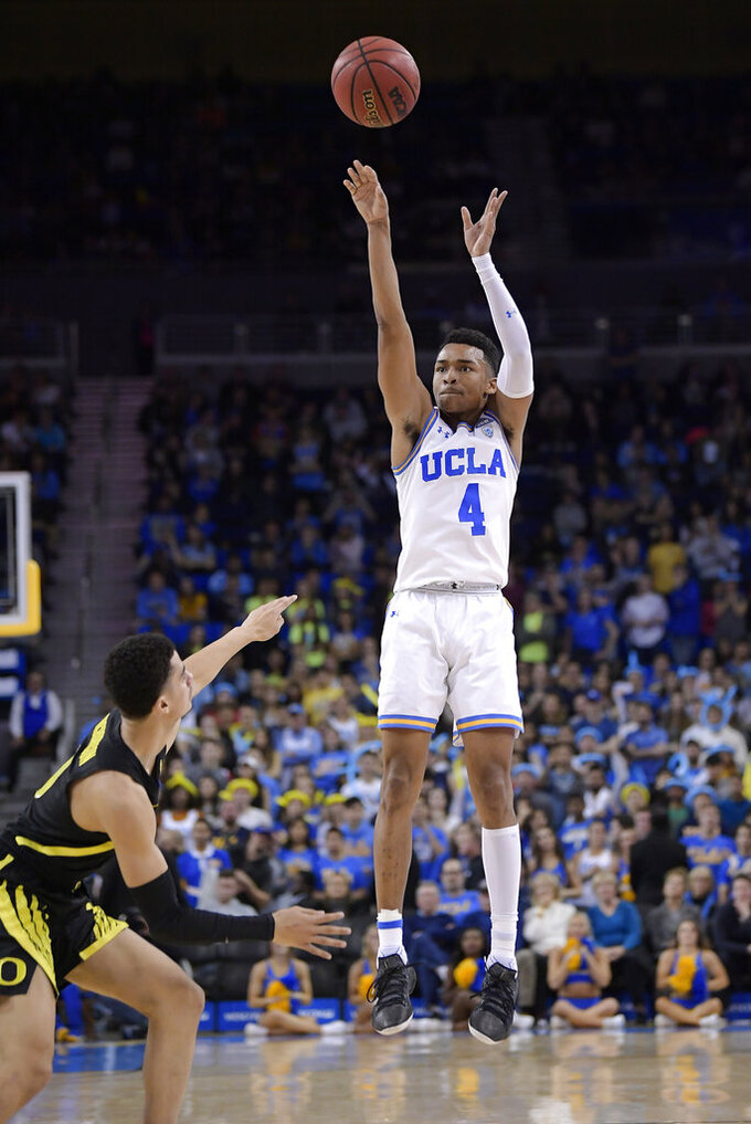 UCLA guard Jaylen Hands shoots as Oregon guard Will Richardson defends during the second half of an NCAA college basketball game Saturday, Feb. 23, 2019, in Los Angeles. UCLA won 90-83. (AP Photo/Mark J. Terrill)