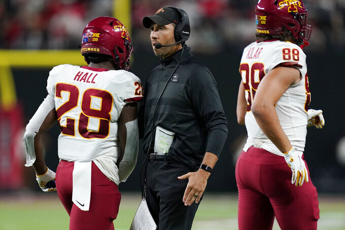 Iowa State coach Matt Campbell congratulates running back Breece Hall (28) and tight end Charlie Kolar (88) during the first half of the team's NCAA college football game against UNLV on Saturday, Sept. 18, 2021, in Las Vegas. (AP Photo/John Locher)