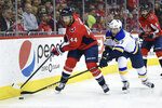 Washington Capitals defenseman Brooks Orpik (44) battles for the puck against St. Louis Blues left wing David Perron (57) during the first period of an NHL hockey game, Monday, Jan. 14, 2019, in Washington. (AP Photo/Nick Wass)