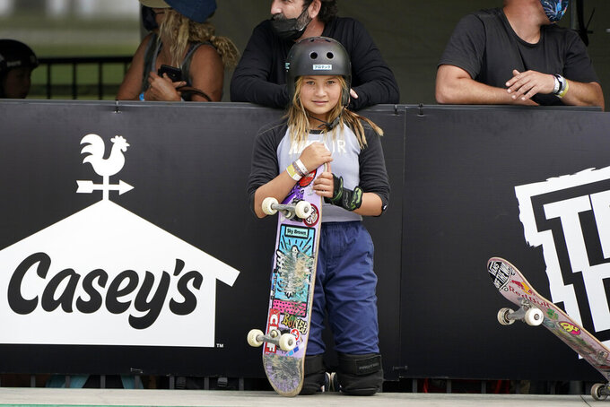 Sky Brown, of Great Britain, waits to start a run during practice for an Olympic qualifying skateboarding event at Lauridsen Skatepark, Wednesday, May 19, 2021, in Des Moines, Iowa. The questions under the magnifying glass at this week's Dew Tour — one of the last major qualifying events for the games in Tokyo in July — is whether the Olympics is ready for skateboarding and, more tellingly, whether skateboarding is ready for the Olympics. (AP Photo/Charlie Neibergall)