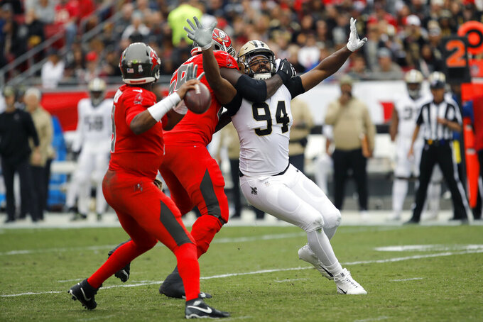 New Orleans Saints defensive end Cameron Jordan (94) gets held by Tampa Bay Buccaneers offensive tackle Demar Dotson (69) as he pressures quarterback Jameis Winston (3) during the first half of an NFL football game Sunday, Nov. 17, 2019, in Tampa, Fla. (AP Photo/Mark LoMoglio)