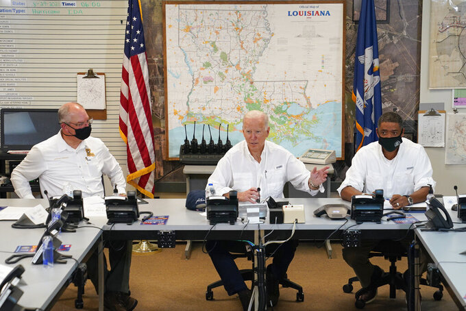 President Joe Biden participates in a briefing about the response to damage caused by Hurricane Ida, at the St. John Parish Emergency Operations Center, Friday, Sept. 3, 2021, in LaPlace, La., as Louisiana Gov. John Bel Edwards, left, and White House senior adviser Cedric Richmond listen. (AP Photo/Evan Vucci)