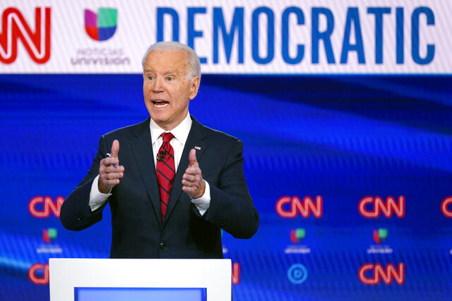 FILE - In this March 15, 2020, file photo, former Vice President Joe Biden participates in a Democratic presidential primary debate at CNN Studios in Washington.  Biden will close out Texas Democrats' virtual convention next month that was moved online over fears of the coronavirus. The announcement Thursday, May 28 2020, rounds out an unusual slate of big names that Texas Democrats have rounded up for their state convention. House Speaker Nancy Pelosi, Sen. Kamala Harris of California and Sen. Elizabeth Warren of Massachusetts will also speak at the weeklong event via video.  (AP Photo/Evan Vucci, File)