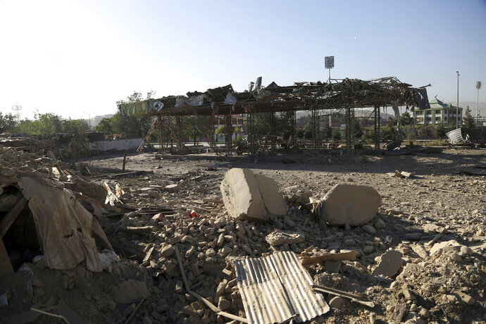 A damaged oil station stands following Monday's attack in Kabul, Afghanistan, Tuesday, July 2, 2019. The Taliban set off a powerful bomb in downtown Kabul on Monday, killing a several people and wounding more than a hundred, and sending a cloud of smoke billowing over the Afghan capital. (AP Photo/Rahmat Gul)