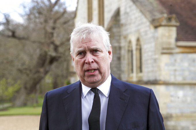 """FILE - In this Sunday, April 11, 2021 file photo, Britain's Prince Andrew speaks during a television interview at the Royal Chapel of All Saints at Royal Lodge, Windsor, England. Attorneys representing a U.S. woman who claims Prince Andrew sexually assaulted her have asked British courts to formally notify him about her lawsuit after a lawyer for the prince maintained this week that Andrew has not been properly notified of the """"baseless"""" civil action. (Steve Parsons/Pool Photo via AP, File)"""
