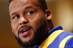FILE - In this Jan. 31, 2019, file photo, Los Angeles Rams defensive end Aaron Donald speaks during a press conference ahead of the NFL Super Bowl 53 football game against the New England Patriots in Atlanta. Two-time reigning defensive player of the year Aaron Donald is always searching for out-of-the-box ways to improve his game. That's why the Rams defensive lineman trained with knives again this offseason. That's right, knives, of the plastic variety, of course, in order to improve his eye-hand coordination. His real driving force? That loss to the New England Patriots in the Super Bowl last February. (AP Photo/John Bazemore, File)