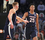 Virginia guard Trey Murphy III, right, is congratulated by Sam Hauser after a basket against Georgia Tech during an NCAA college basketball game Wednesday, Feb. 10, 2021, in Atlanta. (Curtis Compton/Atlanta Journal-Constitution via AP)