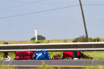 Luggage lies on the side of the road Saturday, July 20, 2019, after a three-vehicle crash left five dead and seven injured on U.S. 59 in South Texas. Multiple people traveling in the passenger van were pronounced dead at the scene of the crash. Seven people total were injured. (Shelby Miller/The Victoria Advocate via AP)