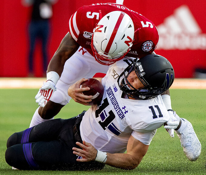 Nebraska's Cam Taylor-Britt (5) makes contact with Northwestern's Aidan Smith during the second half of an NCAA college football game, Saturday, Oct. 5, 2019 in Lincoln, Neb. (Francis Gardler/Lincoln Journal Star via AP)