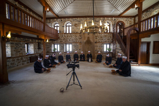 Imams attend the Ramadan prayer at a mosque empty of faithful due to social distancing guidelines during the coronavirus outbreak in Zenica, central Bosnia, Thursday, April 23, 2020. The COVID-19 virus pandemic is cutting off the world's Muslims from their cherished Ramadan traditions. (AP Photo/Almir Alic)